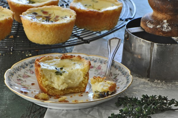 """Delicious thyme scented, custard filled, cornmeal crusted tarts."""