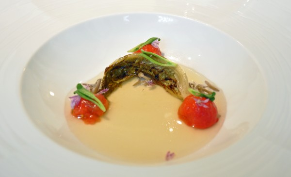 """Romaine and peeled cherry tomatoes are swimming in a bacon broth"""